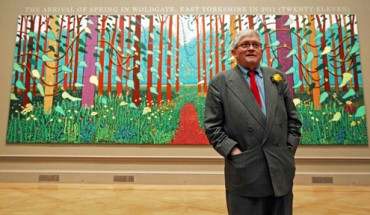 David Hockney with his painting the arrival of spring