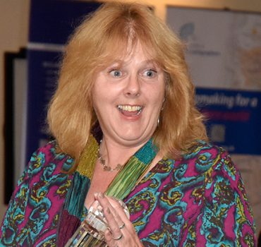 Photo of Jane collecting her award
