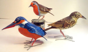 Paper mache kingfisher, robin, and song thrush